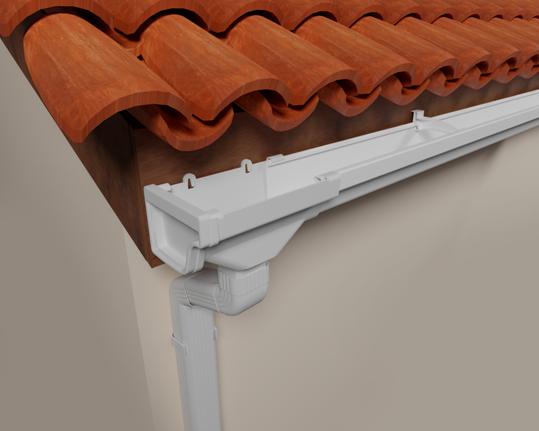 A imagem mostra uma calha retangular branca, fabricada em PVC. Ela está instalada na parte de madeira abaixo do telhado.