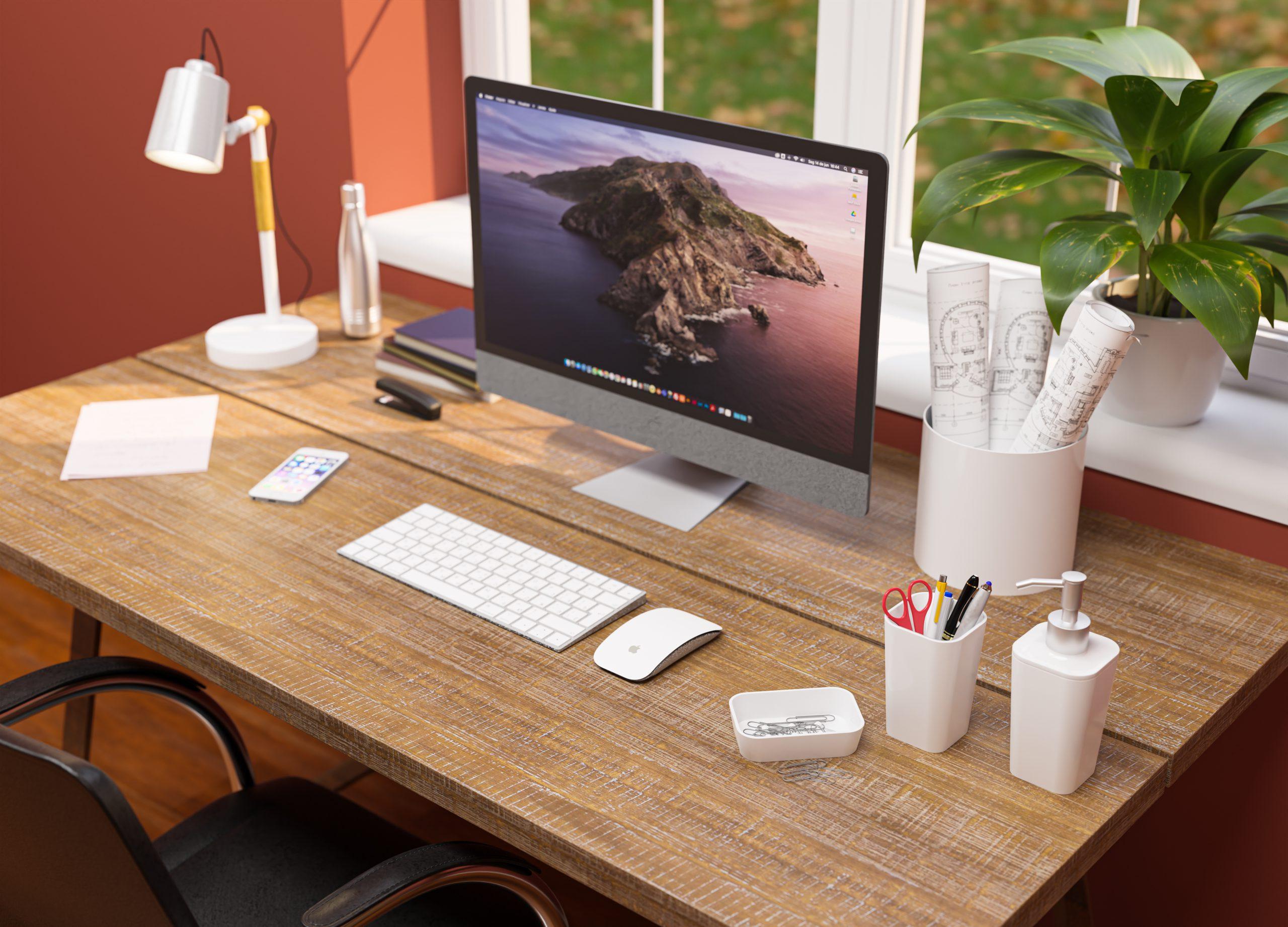 Uma escrivaninha marrom com um Macbook e alguns porta-objetos da linha Office da Astra aparecem na imagem.