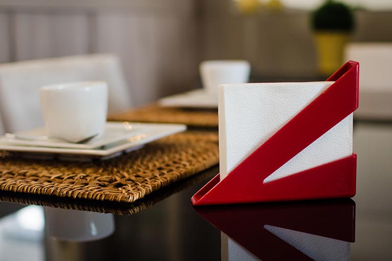 Imagem meramente ilustrativa. Porta-guardanapos ambientado na sala de jantar.